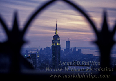 Empire State Building and Twin Towers of the World Trade Center from the top of Rockefeller Plaza in midtown Manhattan. 1991