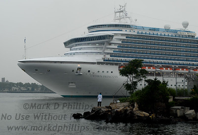 The Crown Princess returns to the Brooklyn Cruise Terminal in Red Hook after its accident off Florida.  The ship backs down Buttermilk Channel past Valentino Pier in Red Hook as Jason Graham fishes.