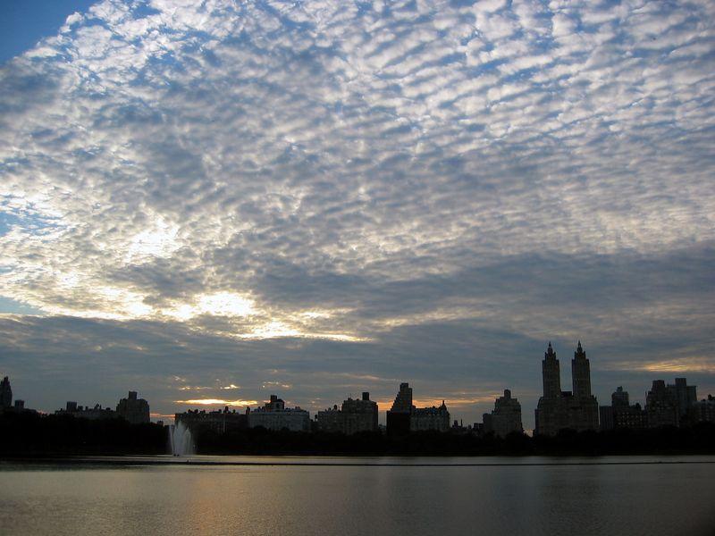 Skyline across reservoir at dusk