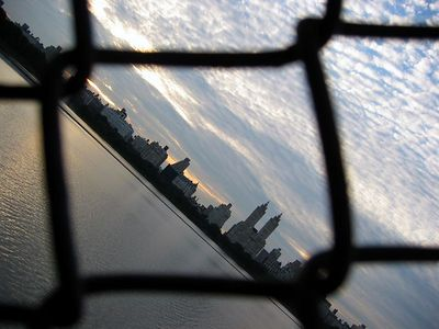 Skyline through reservoir fence