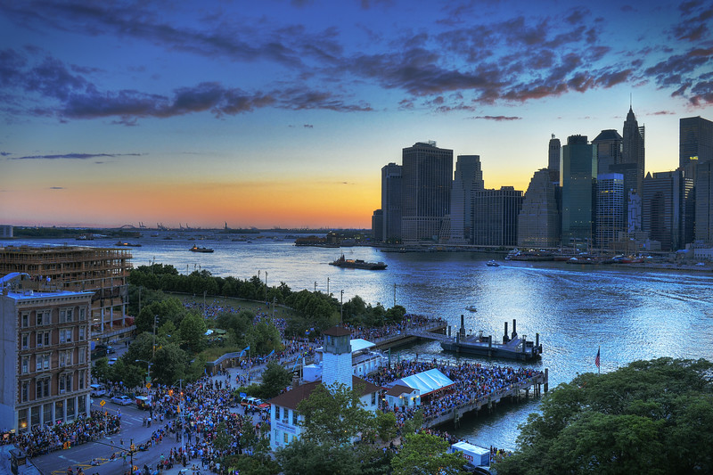 Sunset over Lower Manhattan as people gather to watch Macy's Fireworks display on the 4th of July