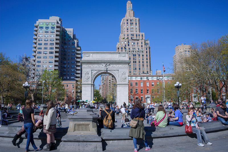 Crowd of people at the fountain near the Washington Square Arch in Washington Sqaure Park on the first warm day of spring, New York, City