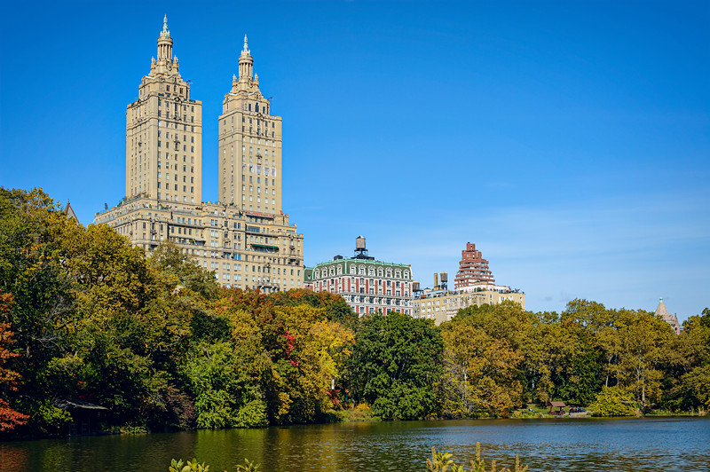 View of the twin towers of the majestic San Remo on the Upper West Side.  The building was designed by Emery Roth in 1930.  This is the view of the San Remo  from The Lake in Central Park, New York City.