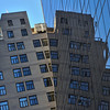 Reflection on the Solow Building at 9 West 57th Street, New York City
