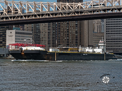 Passing under the Queensboro bridge, westbound East River.