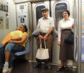 On my way home on the L train, I saw this Jewish couple.  They were talking.  They looked like they'd just arrived from a shtetl in Galicia in 1920.