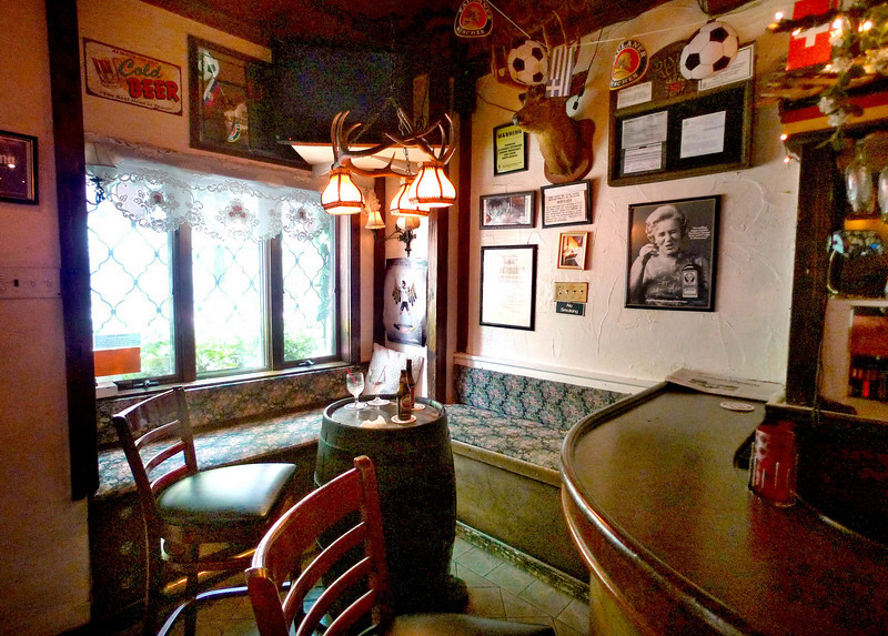 A comfortable corner at the end of the bar.  Great for hanging out in the evening.