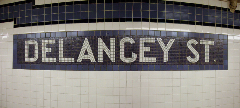 Delancey Street is named after Cyrus W. Street...  No, seriously, it's named after James De Lancey, whose farm was located in what is now the Lower East Side. <br>     Incidentally, the curvature of the lines is due to the fact that this image is a panorama made by digitally stitching multiple prime photos. Several of the images in this gallery were produced this way.
