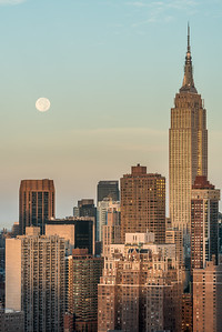 The Harvest Moon setting next to Empire State Building
