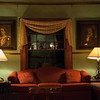 Main parlor with portraits of the original owners from the late 1800's.