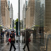 Reflection of Chrysler Building and 42nd Street on a rainy day