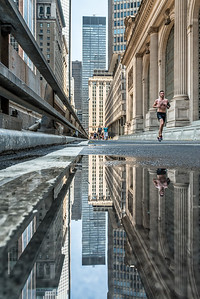 Puddle reflection of Grand Central terminal from Park Avenue Viaduct