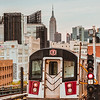 View of Empire State Building and the 7 train