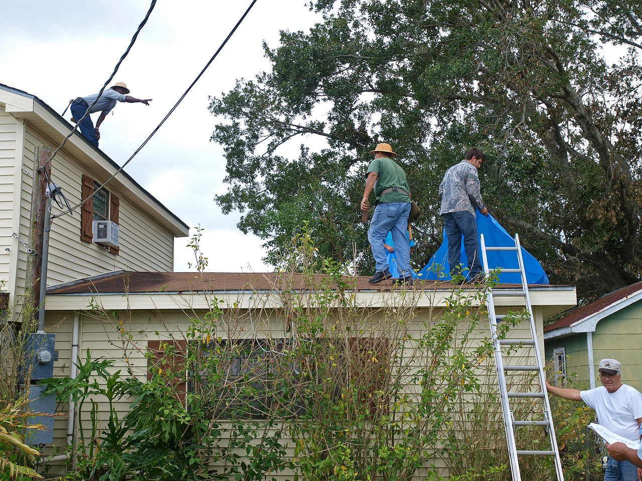 Jehovah's Witnesses Disaster recovery 1st response team tarping roofs in Galliano LA.