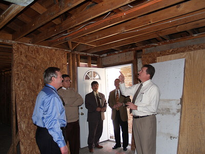Front Right Brother Wendell Gieger Chairman of the Baton Rouge Relief committee shows a home being repaired to John Eppolito a Houston Committee Member.