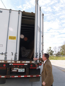 Houston Relief Brother Scott  Carter inspects a Trailer used for warehousing at Marrero.