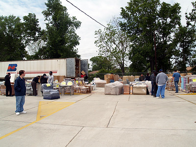 Provisions are staged in the parking lot by family or case numbers