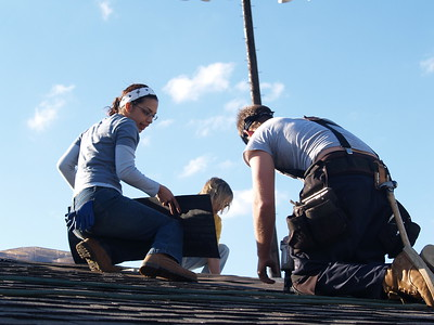 JW Relief Roofing - This local sister is helping the volunteers from out of town