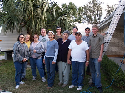 JW Relief Roofing - The roofing crew and the home owners
