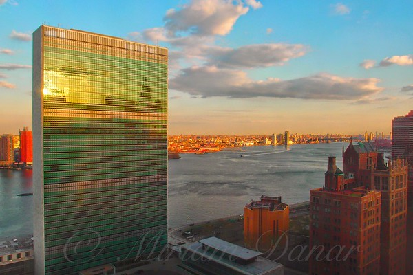 United Nations Building at Sunset with Chrysler Building Reflection - Famous Buildings and Landmarks of New York City