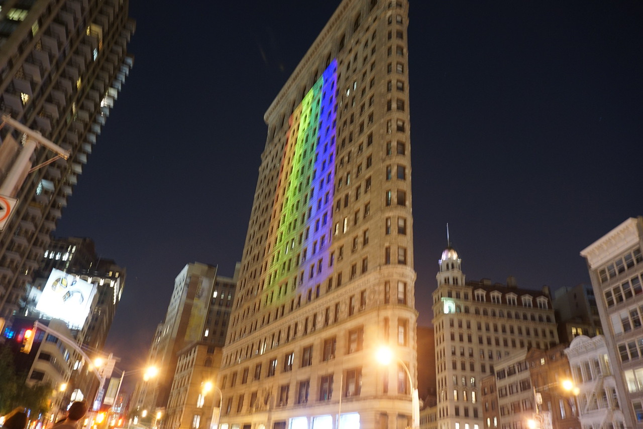 Flat iron building with pride colors for the following day's pride parade.