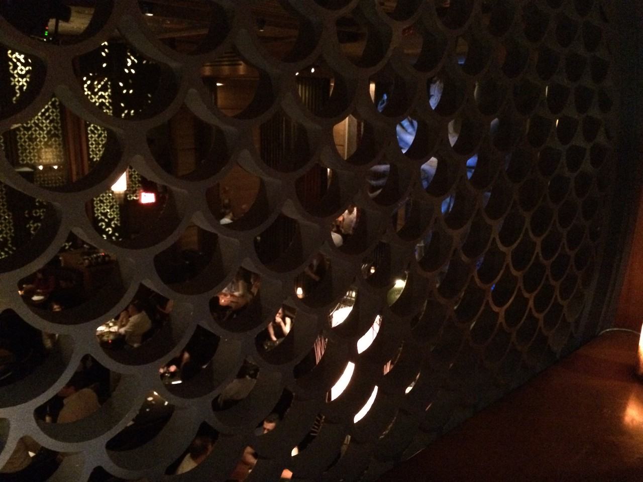 From the long hallway, looking down at the dining scene/buddha