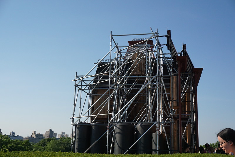 Scaffolding behind the installation.