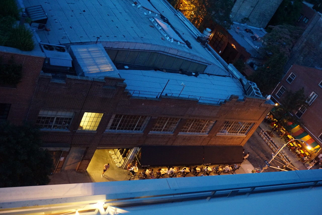 Looking down from Laura's rooftop, busy restaurants with outdoor seating. Nice!