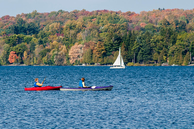 Kayakers and a Sailboat on Cazenovia Lake in Cazenovia, NY