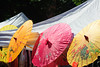 Columbus Avenue, New York. Street Fair. Paper umbrellas