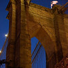 tower of the Brooklyn Bridge after dark