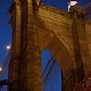 tower of the Brooklyn Bridge after dark