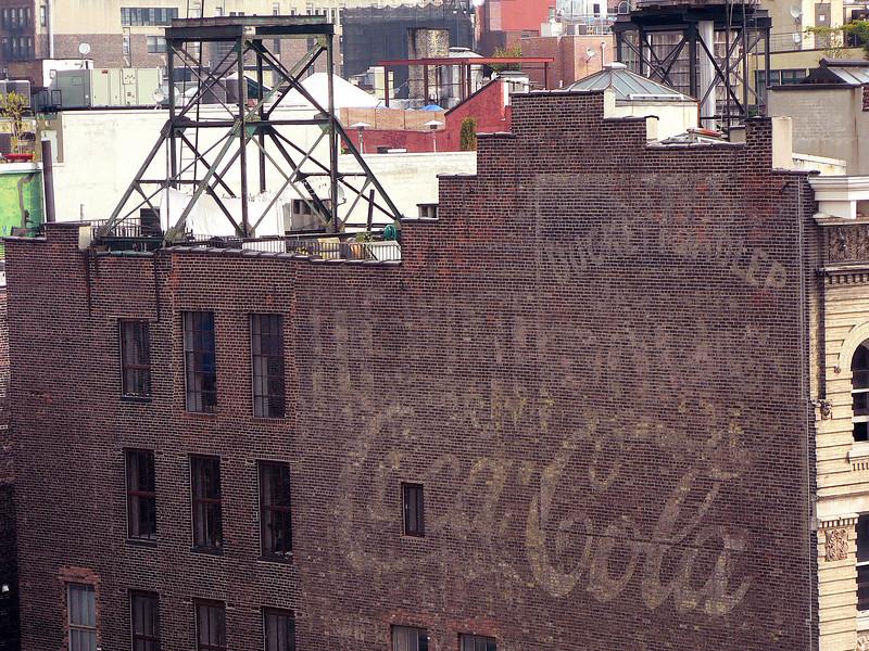 faded Coca-Cola brick wall