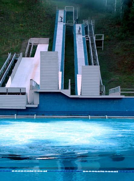 Ski Jumpers Practice on Water Slides