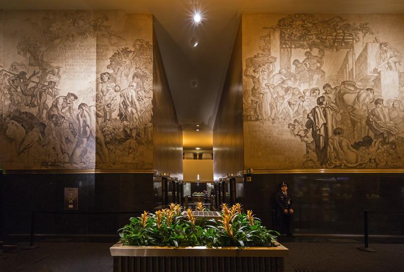 cop planter & bizarre murals inside GE Bldg Rockefeller Center
