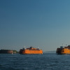 two Staten Island Ferries passing Governor's Island