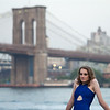 model with blue dress in front of Brooklyn Bridge
