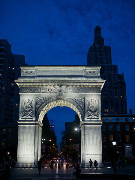 Fifth Ave seen through Washington Square arch at dusk