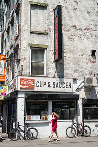 Cup & Saucer cafe with woman in red