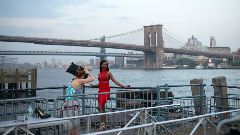 red dress model & photographer in front of Brooklyn Bridge