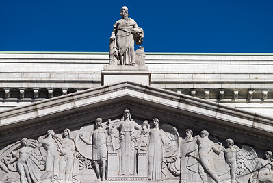 courthouse pediment featuring Justitia