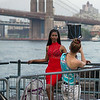 model with red dress Brooklyn Bridge