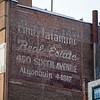 Emil Lalamini Real Estate ghost sign