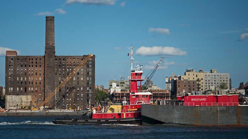 tugboat pushing Bouchard barge