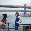 photographer with model in front of Brooklyn & Manhattan Bridges