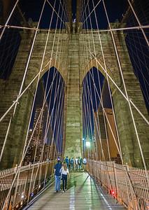 Brooklyn Bridge pedestrian walk at night vertical panorama