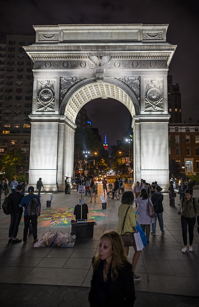 Washington Square arch at night with Empire State Building and Rebecca