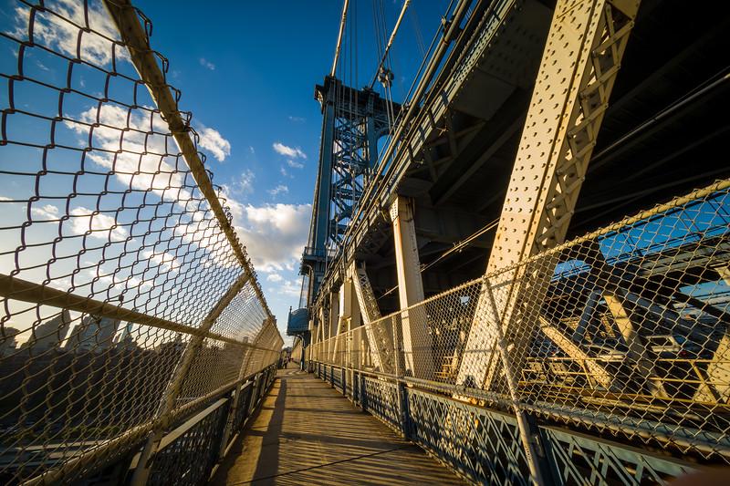 sidewalk of Manhattan Bridge looking back at Manhattan