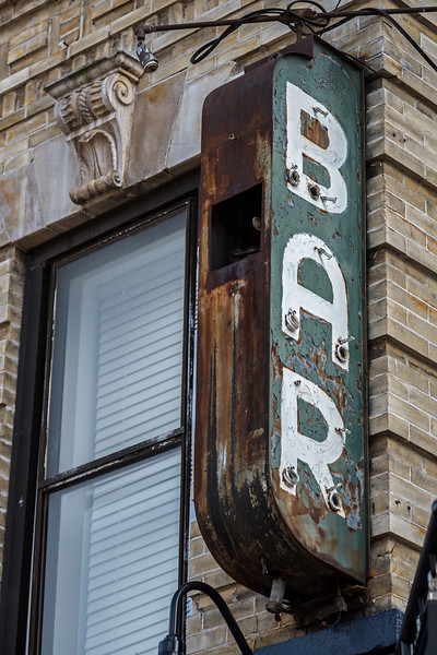 remains of neon Bar sign Delancey St closeup
