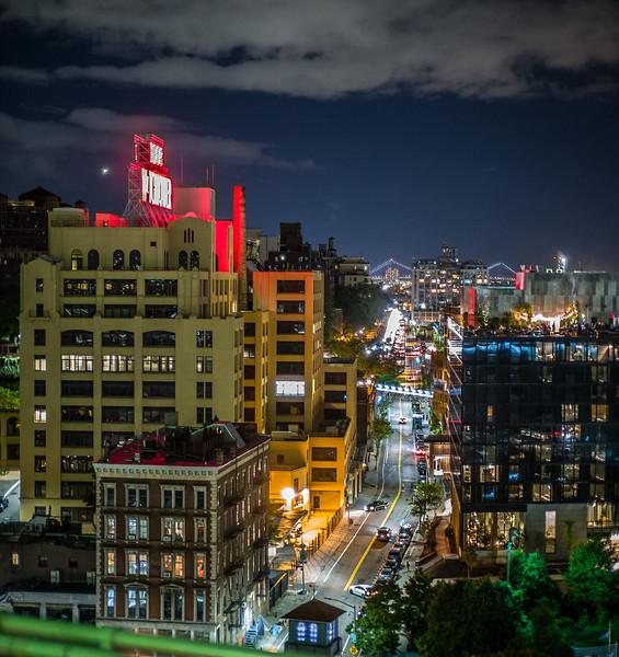 view of Brooklyn from Brooklyn Bridge at night
